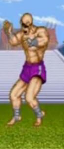 Sagat de Street Fighter I, recibiendo un golpe